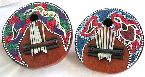 Aboriginal paintings, wooden carvings, indonesian instruments, finger drum, authentic percussion, decorative decor